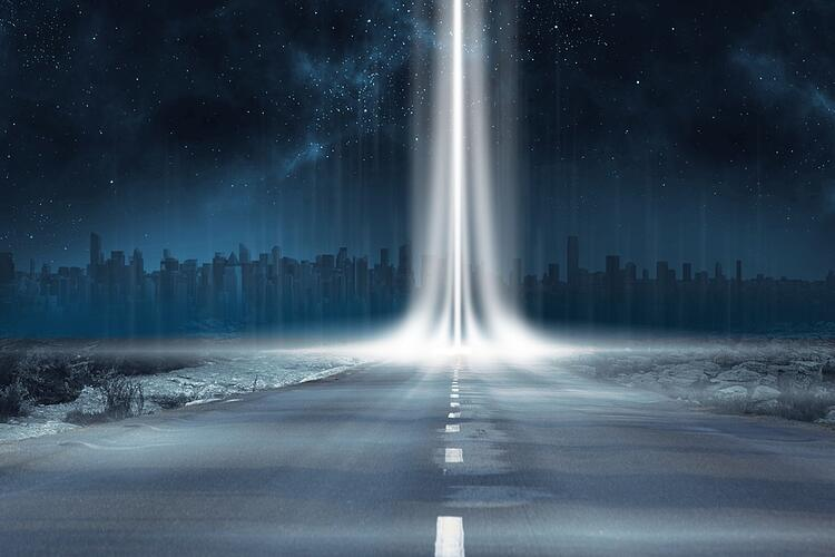 Road leading out to the horizon with light beam.jpeg